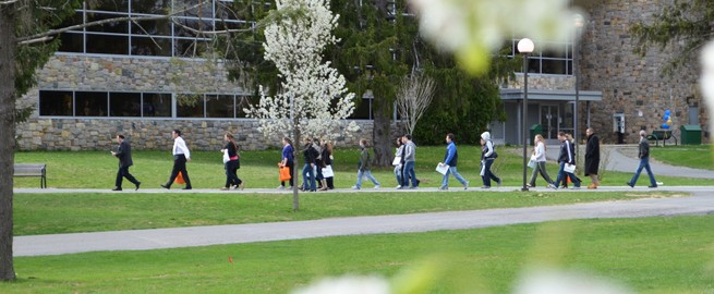 Students walking the scenic campus while on a Open House campus tour