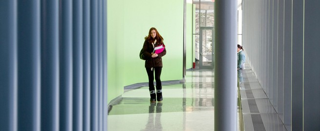 Student walking in hallway of the Gateway Center