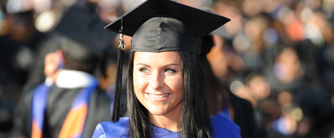 Smiling Student in Cap and Gown at Commencement