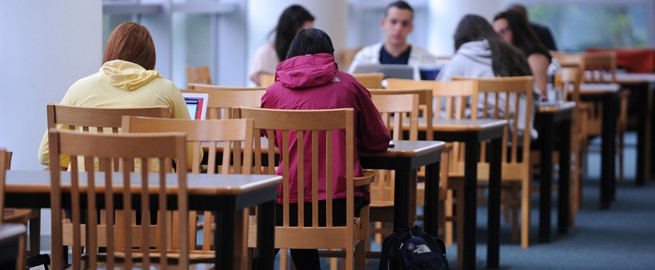 Students are studying hard in the group study area of the Library as they prepare for finals week.