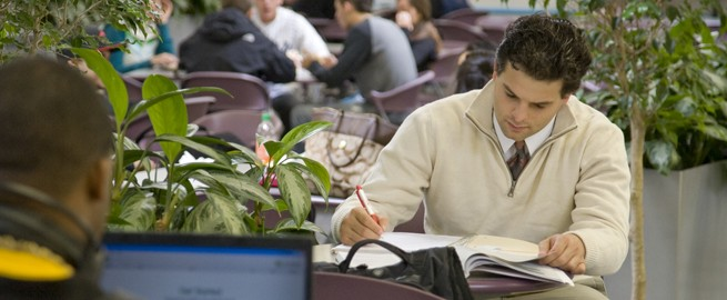 Student reviewing a textbook