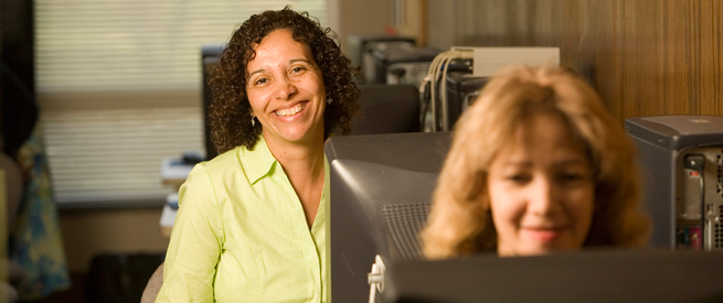 Smiling adult student at a computer