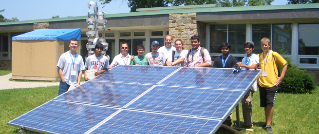 Students Gathered Around a Solar Panel