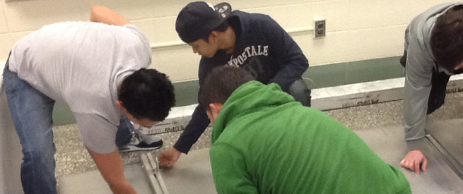 Students Assembling Solar Panels