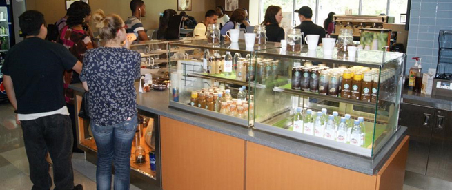 Customers browsing the Crema Cafe