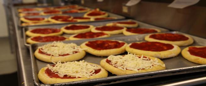 Pizzas being prepared