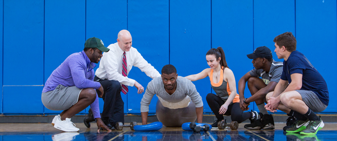 Personal Training students guide an athlete