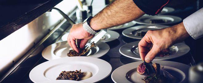 Chefs Preparing Meals in a Restaurant Kitchen
