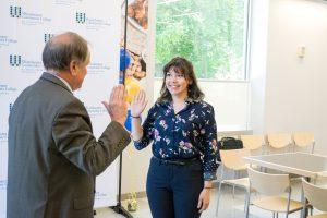 Elizabeth Lugones being sworn in as Student Trustee